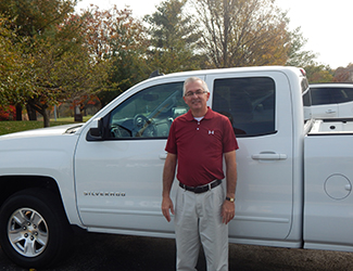 Photo of Wayne Martens standing next to his mobile lending truck